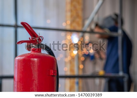 Fire extinguisher are use to prevent fire in welding steel work. #1470039389