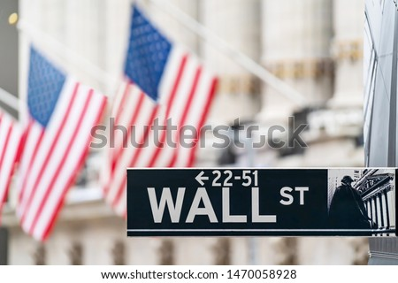 Wall street sign in New York city financial economy and business district with America national flag background. Stock market trade and exchange zone. #1470058928