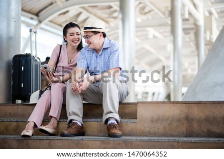 Close up of elderly couples are traveling abroad. #1470064352