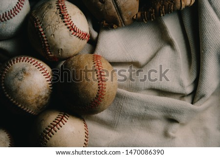 Baseballs on canvas background for sports concept flat lay with used baseball equipment. #1470086390