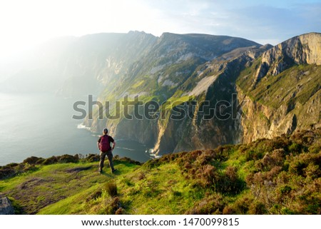Slieve League, Irelands highest sea cliffs, located in south west Donegal along this magnificent costal driving route. One of the most popular stops at Wild Atlantic Way route, Co Donegal, Ireland. Royalty-Free Stock Photo #1470099815