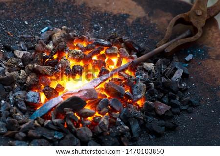 The blacksmith's anvil is made of forged or cast steel. Furnace for blacksmiths. Equipment for forging steel. Blacksmiths Festival of craftsmanship, street exhibition of forging metal. #1470103850