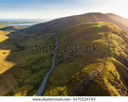 Aerial view of Conor Pass, one of the highest Irish mountain passes served by an asphalted road, located on the south-western end of the Dingle Peninsula, County Kerry, Ireland #1470124763