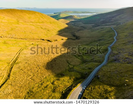 Aerial view of Conor Pass, one of the highest Irish mountain passes served by an asphalted road, located on the south-western end of the Dingle Peninsula, County Kerry, Ireland #1470129326