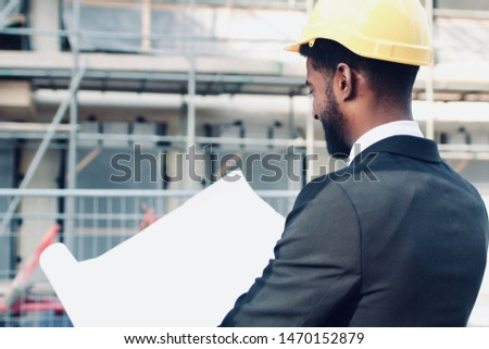 Construction worker and architect outside  #1470152879