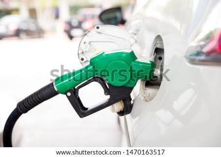 Refill and filling Oil Gas Fuel at station.Gas station - refueling.To fill the machine with fuel. Car fill with gasoline at a gas station. Gas station pump.  #1470163517