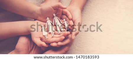 hands holding paper family cutout, family home, foster care, homeless support,world mental health day, Autism support,homeschooling education, domestic violence, social distancing concept #1470183593