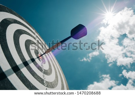 Bullseye is a target of business. Dart is an opportunity and Dartboard is the target and goal. So both of that represent a challenge in business marketing as concept. #1470208688