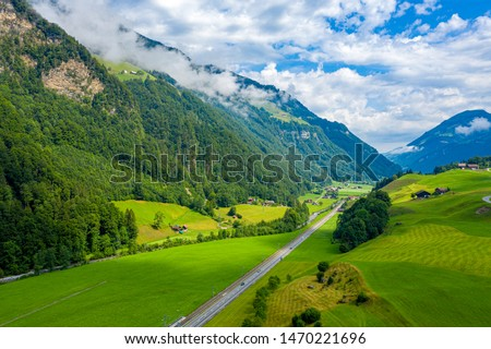 Wonderful aerial view over a valley in the Swiss Alps - Switzerland from above - aerial photography #1470221696