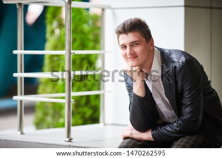 Closeup portrait of a smiling handsome guy. Horizontal frame. space for text. #1470262595