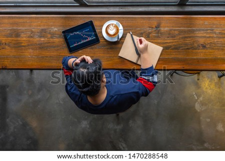 Business analyst having headache while tracking stock market trading graph #1470288548