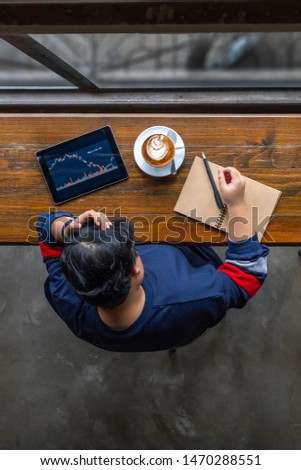 Business analyst grabbing her head while watching stock trading graph #1470288551
