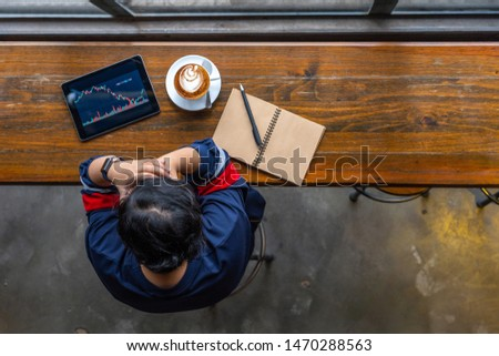 Female investor grabbing her head while watching stock trading graph #1470288563