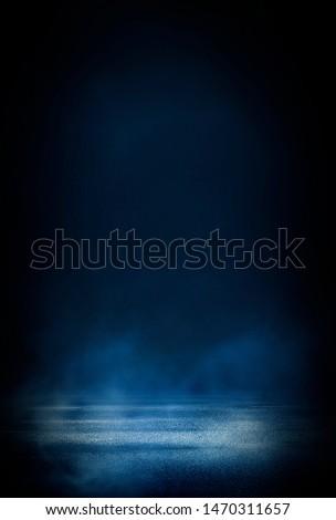 Wet asphalt, reflection of neon lights, a searchlight, smoke. Abstract light in a dark empty street with smoke, smog. Dark background scene of empty street, night view, night city. #1470311657