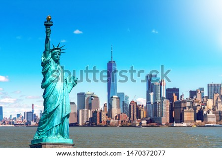 The Statue of Liberty with the One world Trade building center over hudson river and New York cityscape background, Landmarks of lower manhattan New York city. Architecture and building concept #1470372077