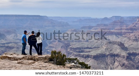 Asian tourists looking over the Grand Canyon (Arizona, USA) #1470373211