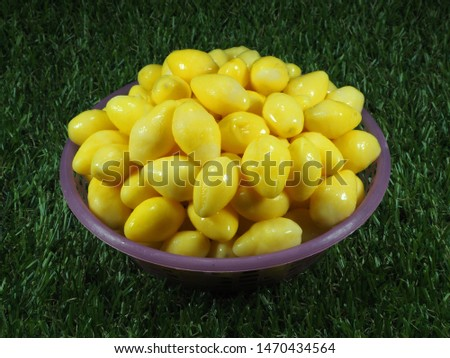 Fresh Yellow Ginkgo in the basket. Ginkgo nuts (Ginkgo Biloba) or Yellow ginkgo seed peel have high nutrition and vitamin. Herbal medicine concept. #1470434564