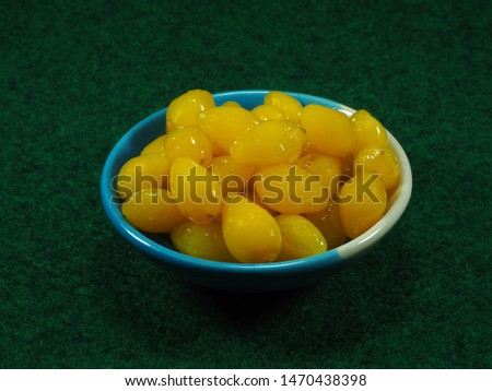 Boiled Yellow Ginkgo with sugar in the plate. Ginkgo nuts (Ginkgo Biloba) or Yellow ginkgo seed peel have high nutrition and vitamin. Herbal medicine concept. #1470438398