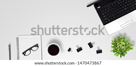 Top view education and office desk with laptop, Coffee, glasses, Flower bouquet, Pen, Paper clip, Notebook with copy space background #1470473867