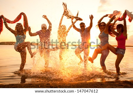 Large group of young people enjoying a beach party #147047612