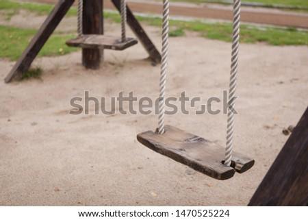 Empty swing on children playground,Children swing in the park,wooden swing,wooden swing on the lawn during #1470525224