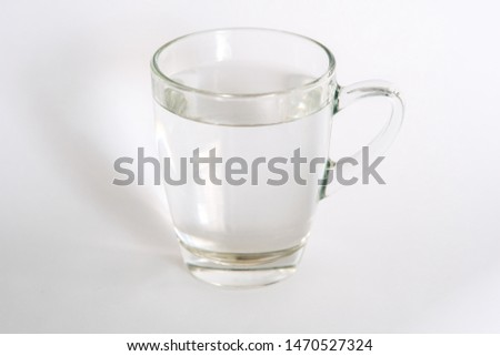 Cup of clear water on white background #1470527324