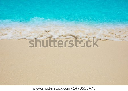 Soft waves of blue sea on the Maldives beach for the background. #1470555473