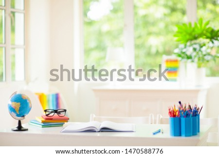 Back to school. Kids bedroom with wooden desk, books, globe, backpack, glasses and pencils. White room with big window for young child. Home interior for girl or boy. Table for homework and study. #1470588776