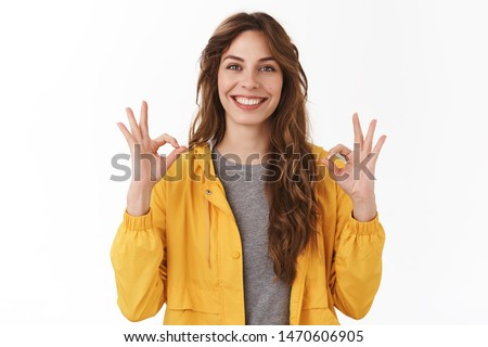 Perfect app recommend. Satisfied beautiful caucasian girl 25s show okay ok excellent gesture smiling broadly optimistic assured gaze camera totally approve awesome startup, standing white background #1470606905
