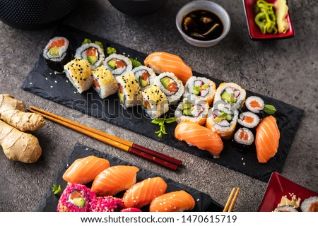 japanese sushi food. Maki ands rolls with tuna, salmon, shrimp, crab and avocado. Top view of assorted sushi. Rainbow sushi roll, uramaki, hosomaki and nigiri.  #1470615719