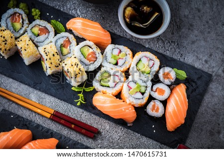 japanese sushi food. Maki ands rolls with tuna, salmon, shrimp, crab and avocado. Top view of assorted sushi. Rainbow sushi roll, uramaki, hosomaki and nigiri.  #1470615731