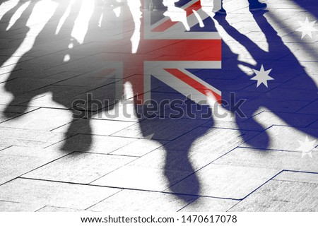 Australian Flag as Background and Silhouettes of People - conceptual Picture about Independence Vote Patriotism political situation and Migrants
