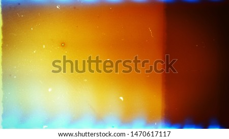 Abstract film texture background with heavy grain, dust and light leak #1470617117