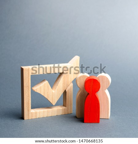 people stand near the checkbox for voting in elections. Lobbying interests, election corruption, voter bribery, and rigging election results. Presidency or parliamentary elections. Selective focus #1470668135