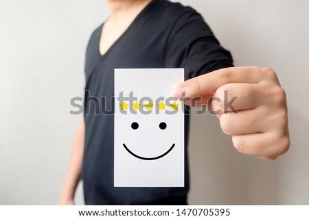 Customer service experience and business satisfaction survey. Man holding card with smiley face with five star #1470705395