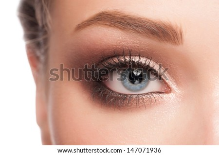 Close-up image of beautiful woman blue eye with bright makeup  #147071936
