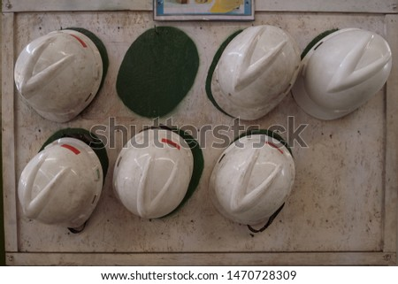 white Put on storage hard safety helmet hat for safety project of workman as engineer or worker, on concrete floor on city Disappear #1470728309