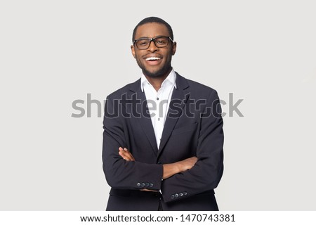 Happy african american young businessman in formal suit wearing eyeglasses portrait. Smiling millennial confident black guy posing for photo, looking at camera, isolated on grey studio background. #1470743381