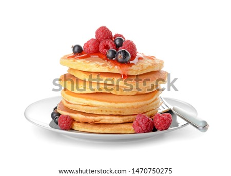 Plate with tasty pancakes and berries on white background Royalty-Free Stock Photo #1470750275