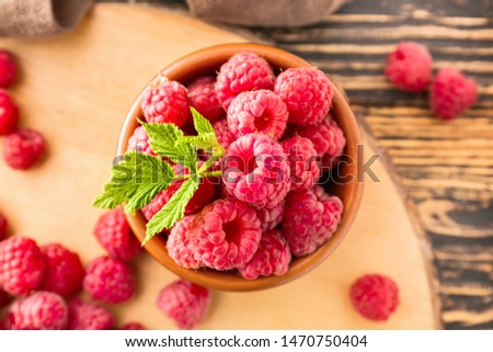Bowl with fresh raspberries on table, closeup #1470750404