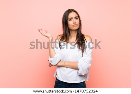 Young woman over isolated pink background unhappy for not understand something #1470752324
