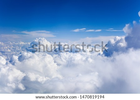 White cumulus clouds on clear blue sky background closeup, overcast skies backdrop, fluffy cloud texture, beautiful sunny cloudscape heaven, ozone layer illustration, scenic cloudy weather, copy space Royalty-Free Stock Photo #1470819194
