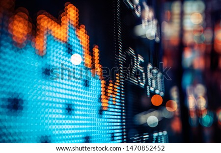 Display of Stock market quotes with city lights reflect on glass #1470852452