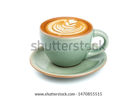 Side view of hot latte coffee with latte art in a ceramic green cup and saucer isolated on white background with clipping path inside. Image Stacking Techniques. #1470855515
