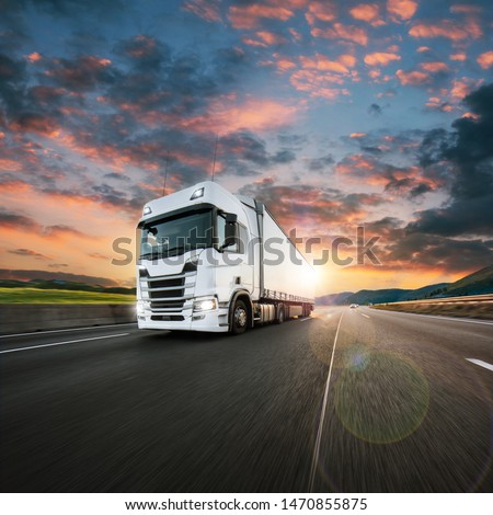 Truck with container on highway, cargo transportation concept. Shaving effect. #1470855875