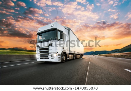 Truck with container on highway, cargo transportation concept. Shaving effect. #1470855878