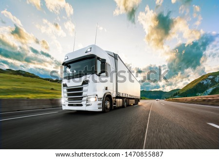 Truck with container on highway, cargo transportation concept. Shaving effect. #1470855887