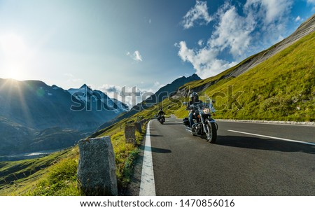 Motorcycle driver riding in Alpine highway, Nockalmstrasse, Austria, central Europe. #1470856016