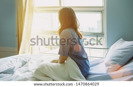 recovered from the ill at hospital of patient. backyard of woman look outside hospital for seeking opportunity and better life,Patients is quarantine to recovered from corona pandemic illness. Royalty-Free Stock Photo #1470864029