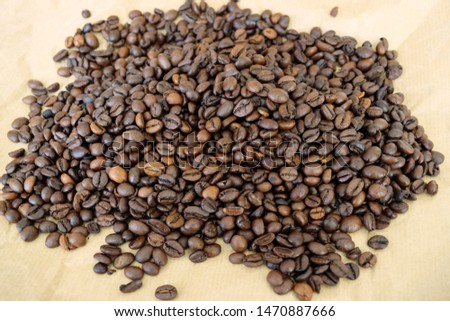brown and gold coffee beans close up #1470887666